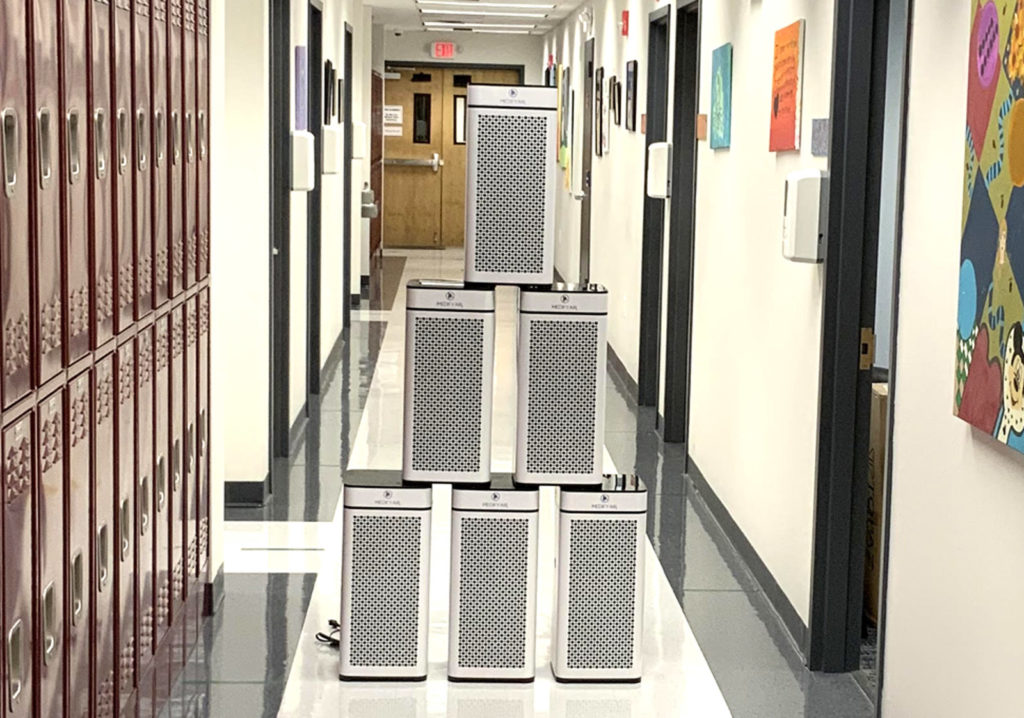Some of the air purification systems placed in rooms throughout the school.
